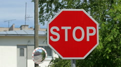 A stop signage on the side of the road Stock Footage