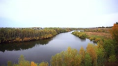 View from the cliff on Autumn forest and river in the fall season Stock Footage