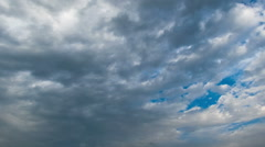 Storm clouds moving in the blue sky Stock Footage