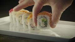Serving Sushi in Japanese Restaurant Stock Footage