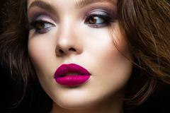Beautiful young model with pink lips Stock Photos