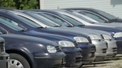 Black cars being parked on the parking lot Stock Footage