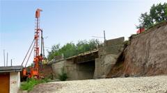Pile rig repair bridge over rail road Stock Footage