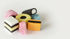Camera move round a heap of liquorice sweets. Stock Footage