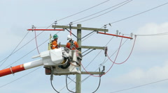 Two Hydro Linemen Joining New Wires On Telephone Pole Stock Footage