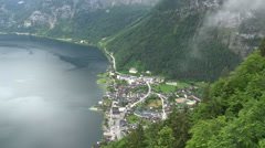 Alps village at mountain lake coast frome above Stock Footage