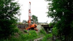 Pile poppethead on railroad and bridge Stock Footage