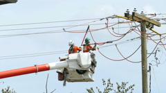 Two Hydro Linemen Installing New Wires On Telephone Pole Stock Footage