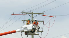 Two Hydro Linemen Using Tools On The Job Stock Footage