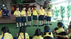 Students primary education activity singing Stock Footage