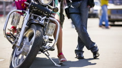 Couple Near Cool Motorcycle Stock Footage