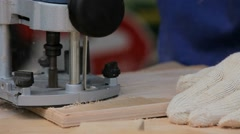 Work Carpenter With an Electric Hand-Milling Cutter Stock Footage