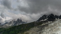 Aguilles du Chamonix and glaciers dark clouds time lapse 4K Stock Footage