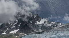 Aguille du Midi and glaciers fog rising time lapse Stock Footage