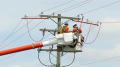 Two Hydro Linemen Splicing New Wires On Telephone Pole - stock footage