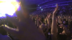 Many people waving hands, supporting singer performing at popular TV talent show Stock Footage