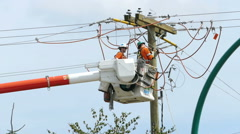 Two Hydro Linemen Attaching New Wires On Telephone Pole Stock Footage
