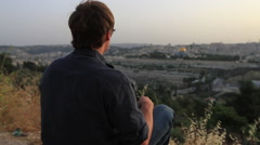 Tourist Looking On to the Old City on the Mount of Olives Jerusalem, Israel Stock Footage