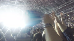 Rock concert atmosphere. Hands of many people applauding in air. Show on stage - stock footage