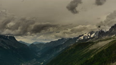 Aguilles du Chamonix and Alpine valley dark clouds 4K Stock Footage