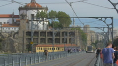Metro train passing through Porto Stock Footage