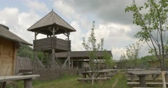 Watchtower, Wooden Benches And Tables, lath Fence of Twigs, Road Paved by Logs, - stock footage