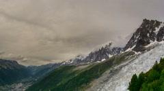 Chamonix valley, mountains glaciers in Mont Blanc massif dark clouds 4K Stock Footage