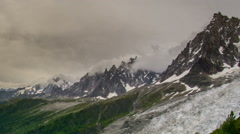 Aguilles du Chamonix and glaciers dark clouds time lapse Stock Footage