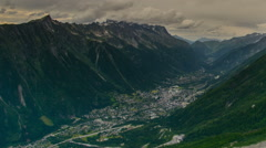 Chamonix village and valley dark clouds Stock Footage