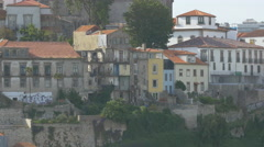 Houses and churches on Douro riverside in Porto Stock Footage