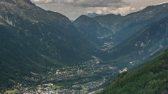 Chamonix village and valley dark clouds time lapse Stock Footage