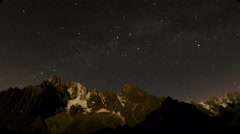 Charpua glacier basin mountains  lit by moonlight and milky way 4K Stock Footage
