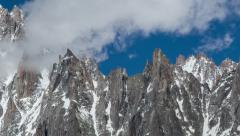 Aguilles du Dru and Aguille Verte alpine faces covered in snow Stock Footage