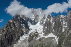 The Dru and Aguille Verte south face Charpua Glacier fog rising time lapse Stock Footage