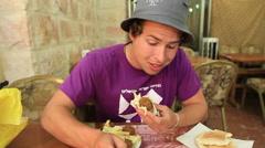Young Man Eats Falafel Stock Footage