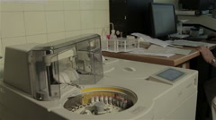 Medical device for analyzing blood, modern digital equipment during work process - stock footage