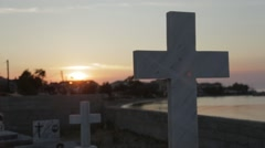 White cross in graveyard at sunset - stock footage