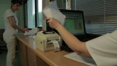 Printing lab results with bar code, close up. Medical technician writes results. - stock footage
