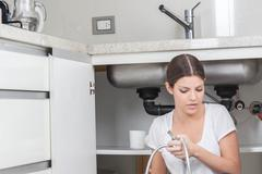Plumber with her pipe Stock Photos