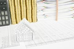 Close up house on finance account have pencil place vertical Stock Photos
