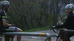 Couple taking a break from road biking Stock Footage