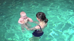 Teaching Infant to Swim - stock footage