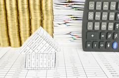 Close up house on finance account with overload gold coins Stock Photos