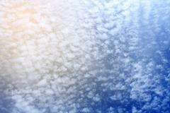 Stock Photo of Clouds background with color filtered image