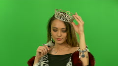 Daring beautiful girl wears a crown - stock footage