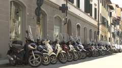 Vespa scooters in a row on street Stock Footage