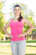 Fitness, Sporty ,Healthy Lifestyle , Smiling Female Relaxing at beautiful sum - stock photo