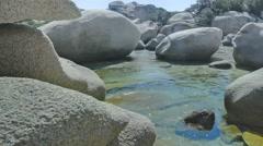 Rocks of Le Piscine di Porto Cuncatu Beach Sardinia Italy - 25FPS PAL Stock Footage