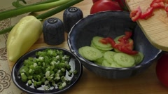 Spring salad with tomato, cucumber and onion Stock Footage