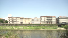 View on Arno river and Ponte Alla Carraia Stock Footage